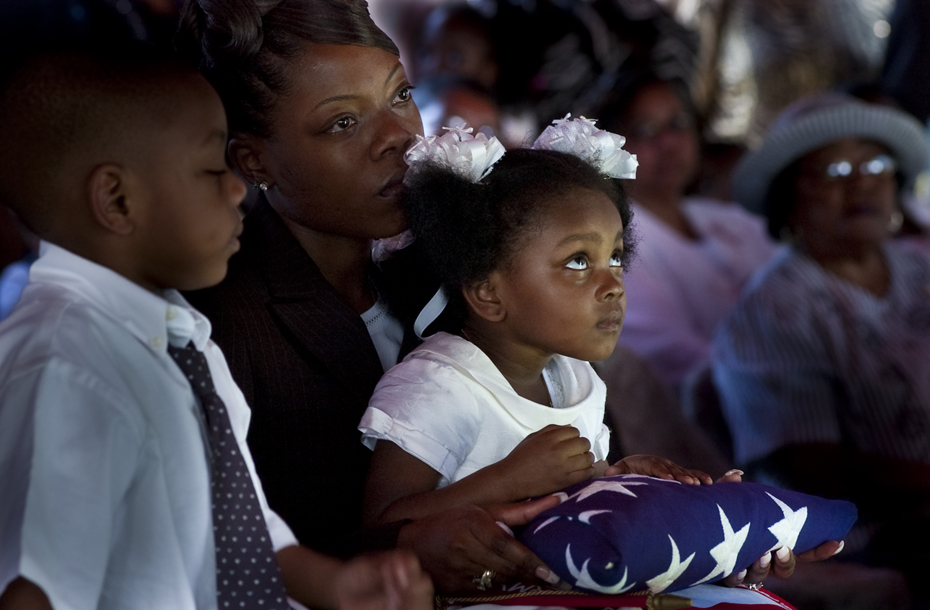 The widow and children of Esau Patterson Jr. after receiving the flag that covered his casket during gravesite services in Ridgeland, SC.