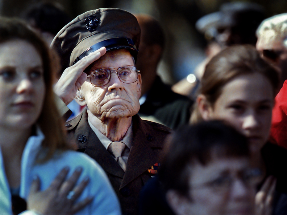 """Retired Marine Master Sgt. Charles Mullins of Beaufort, SC salutes the playing of the """"Star Spangled Banner"""" during Veterans Day at the national cemetery in Beaufort."""