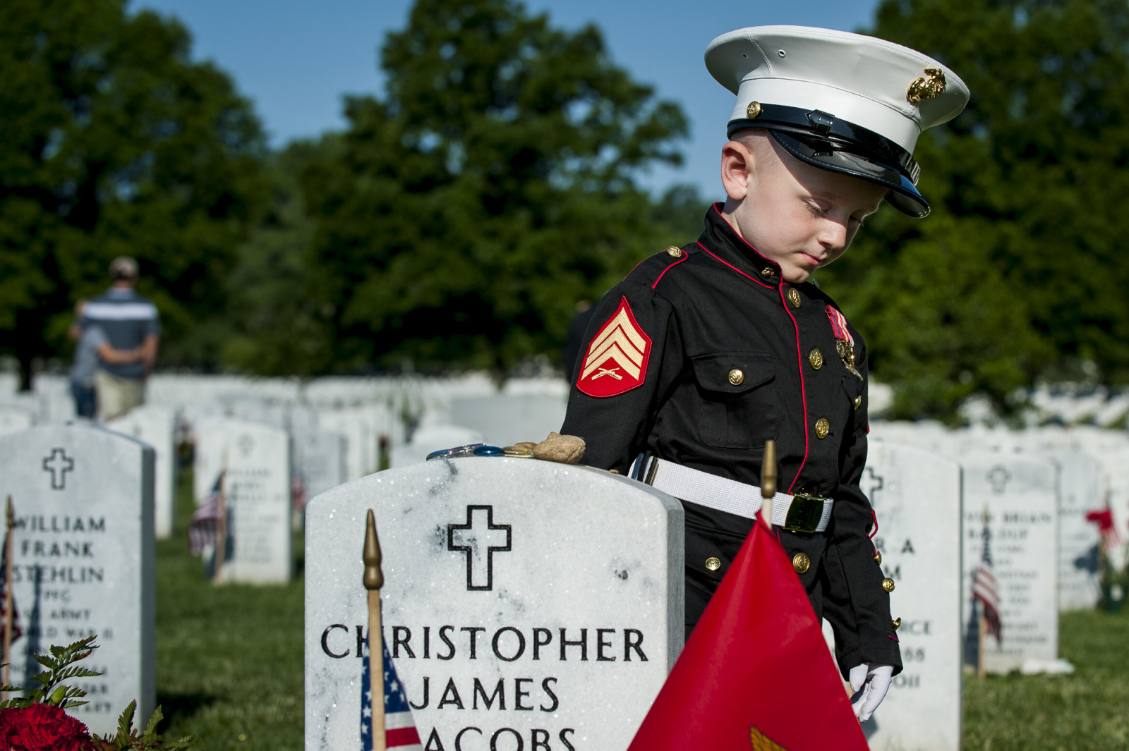 On Memorial Day, Christian Jacobs, 4, of Hertford, NC, walks past the headstone of his father, Marine Sgt. Christopher Jacobs, in Section 60 at Arlington National Cemetery in Arlington, Virginia, USA, on 25 May 2015. (Pete Marovich/ European PressPhoto Agency)