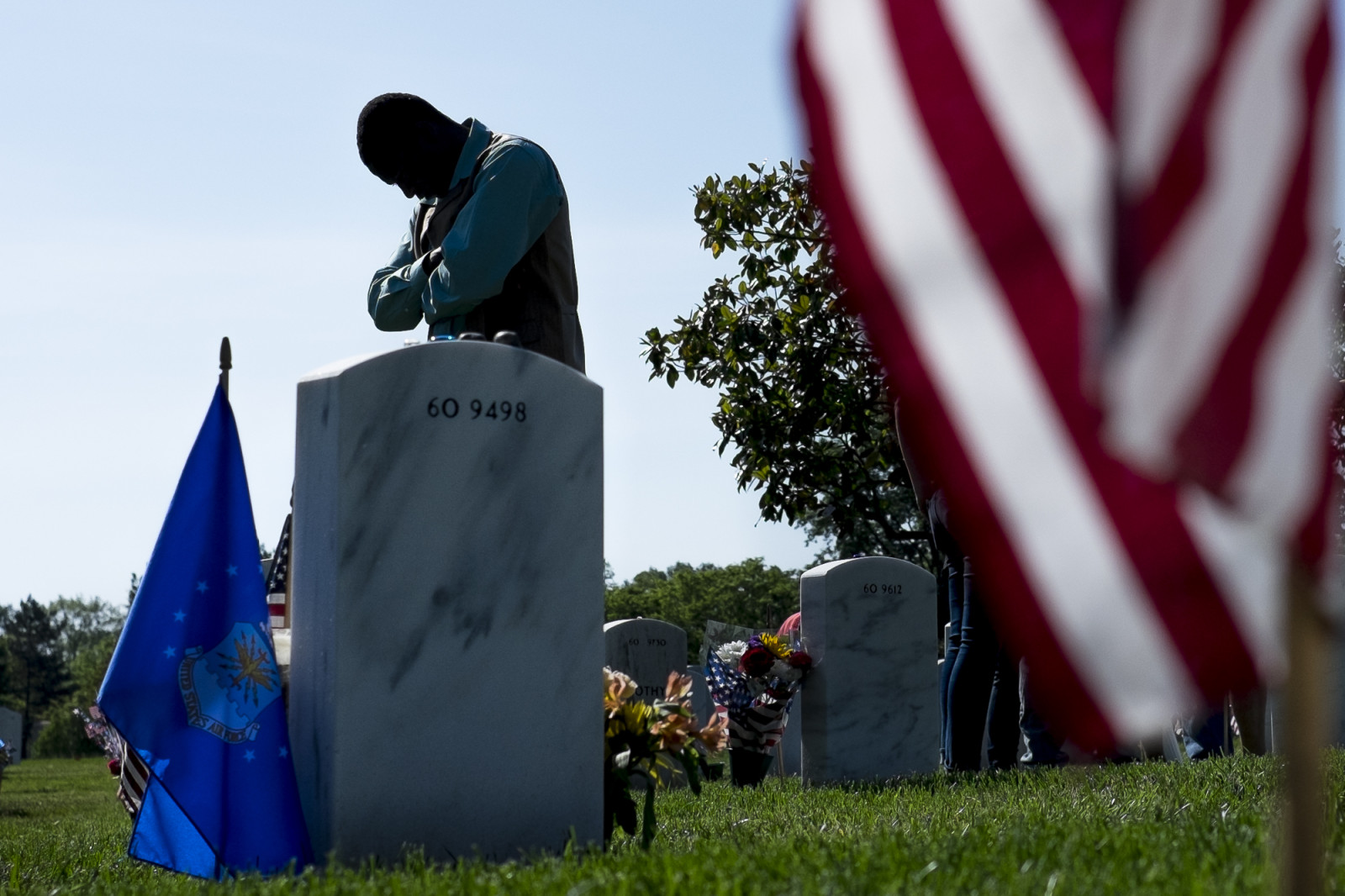 On Memorial Day, Peter Warigi, 40, of Kenya, visits the grave of his brother SSGT Anthony Warigi USA at Arlington National Cemetery in Arlington, Virginia, USA, on 25 May 2015. (Pete Marovich/ European PressPhoto Agency)